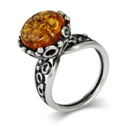 Brilliant Round Cut Baltic Amber Ring in Ornate Silver Setting