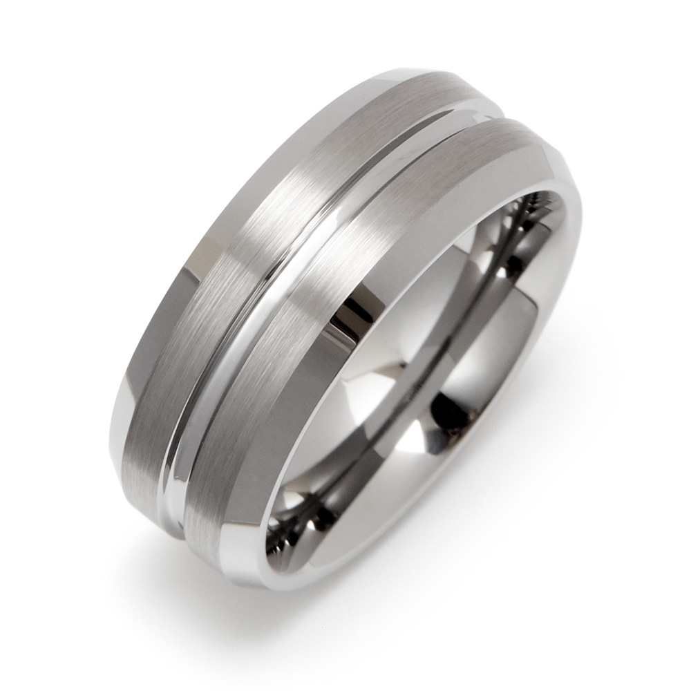 Men's Wide Groove Tungsten Wedding Band This Men's Wide Groove Tungsten Wedding Band is your perfect fit! This tungsten carbide ring is a sleek silver ring with a single thick silver groove that make this ring look like it's a single car raceway, with rounded edges for a comfort-fit design. This band is made with durable Tungsten and can be engraved inside, making it a perfect wedding band.   Details: • Groove Stripe Around Band • Engravable Inside • Tungsten Metal