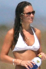 Kate Middleton accents her white bikini with a classic silver bangle bracelet. Steal the style at Eve's!