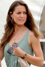 Watches are in this season, and Kate knows it, rocking a small black fashion watch with her breezy mint green dress.
