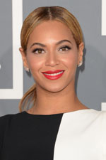 Glamorous and sophisticated, Beyonce complimented her black and white jumpsuit with a simple ponytail and sparkling cocktail earrings. Get her look for less!