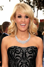Carrie Underwood swept the red carpet with a stunning black gown dazzling three row necklace and walked away with an award at the 2013 Grammy Awards.