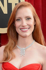 Jessica Chastain is a vision of beauty with long flowing hair and an exquisite flame necklace to match her flame red dress!