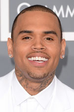 Chris Brown was all smiles at the Grammy Awards with a sharp white suite and a pair of mens stud earrings - not to mention a stunning Rihanna as his date. Get his look here!