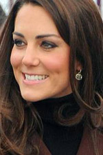 Kate is all smiles as she looks fabulous in this brown blazer and dazzling oval earrings. Get the Duchess�s look here at Eve�s!