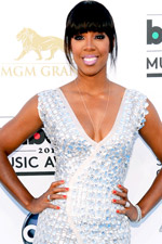 Kelly Rowland wore a silver, shiny confection of a gown and simple glitz like her beautiful tennis bracelet!