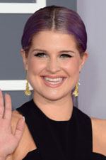 E!'s adorable fashion personality Kelly Osbourne was beautiful at the Grammy music awards wearing a black designer dress and gold jewelry, including a simple pair of gold dangle earrings with matching bracelet.