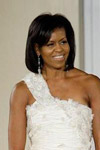 Michelle Obama in a stylish evening dress wearing Glamourous Peardrop Dangle Earrings