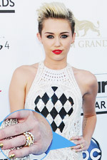 Miley Cyrus is one of the few who can rock her Balmain jumpsuit, matching it with beautiful stacked rings.