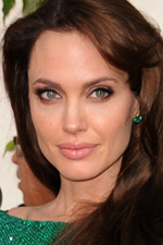 Angelina Jolie dazzled the red carpet at the Awards in sparkling emerald from head to toe.